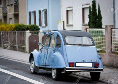 22009926-french-blue-citroen-2-cv-parked-on-a-street-